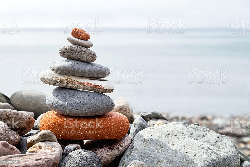 Stack of stones on the coast of the sea. stock photo