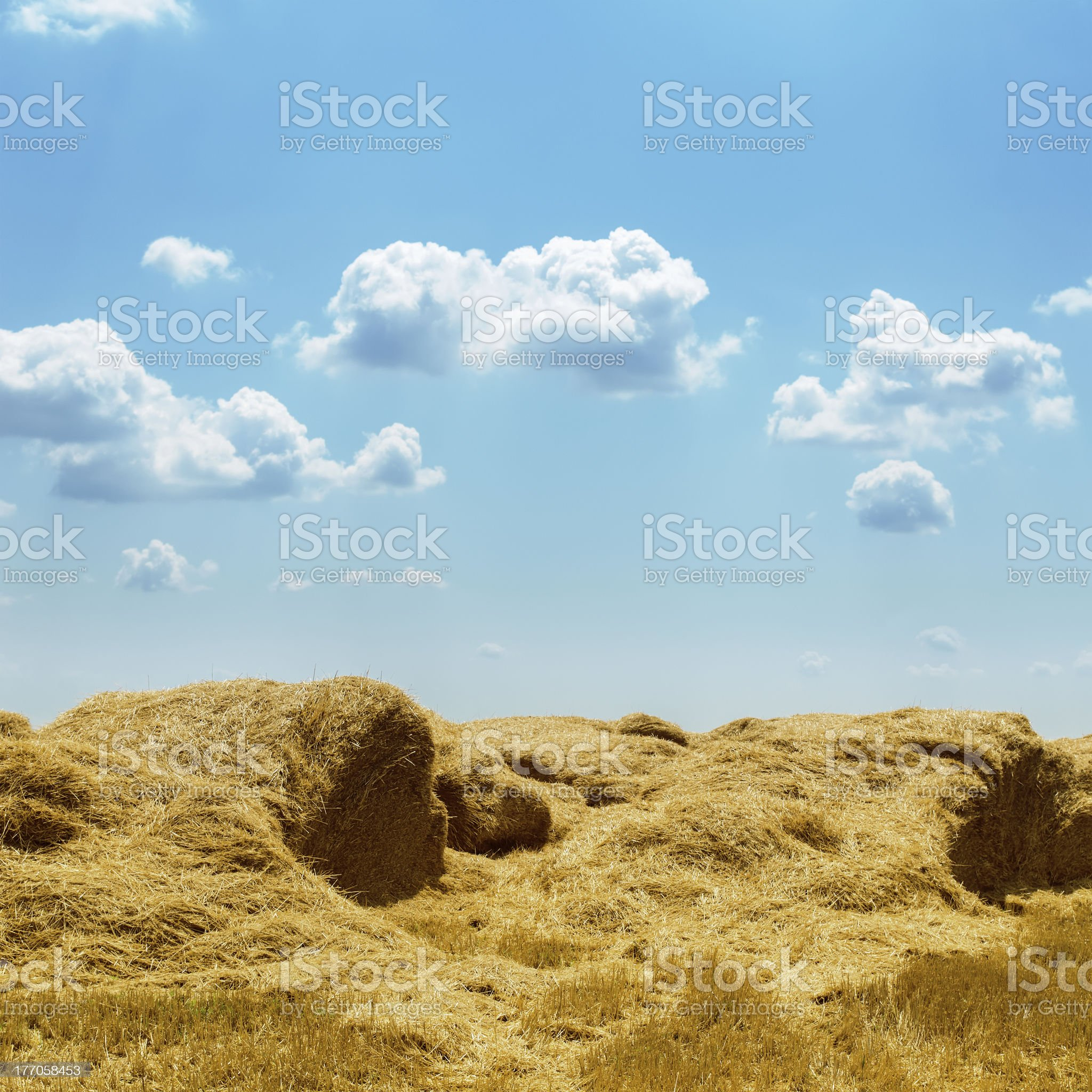 stack of straw and clouds over it royalty-free stock photo