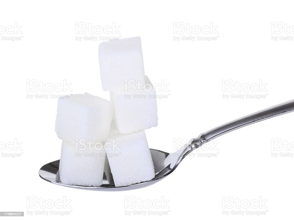 Stack of sugar cubes on spoon stock photo