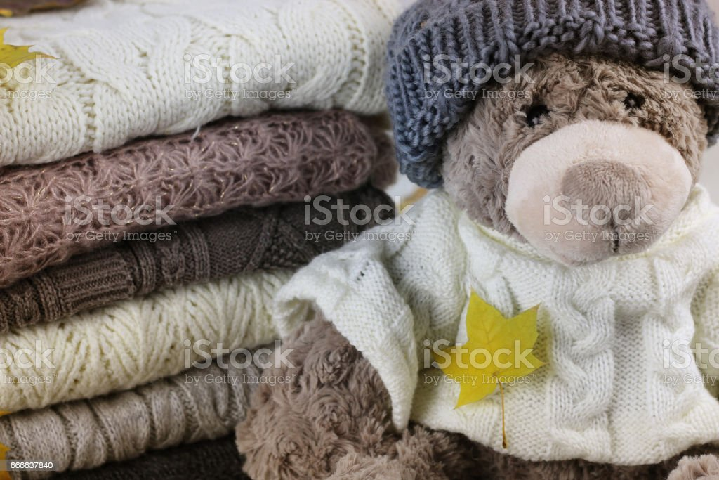 stack of sweaters knitted autumn concept stock photo
