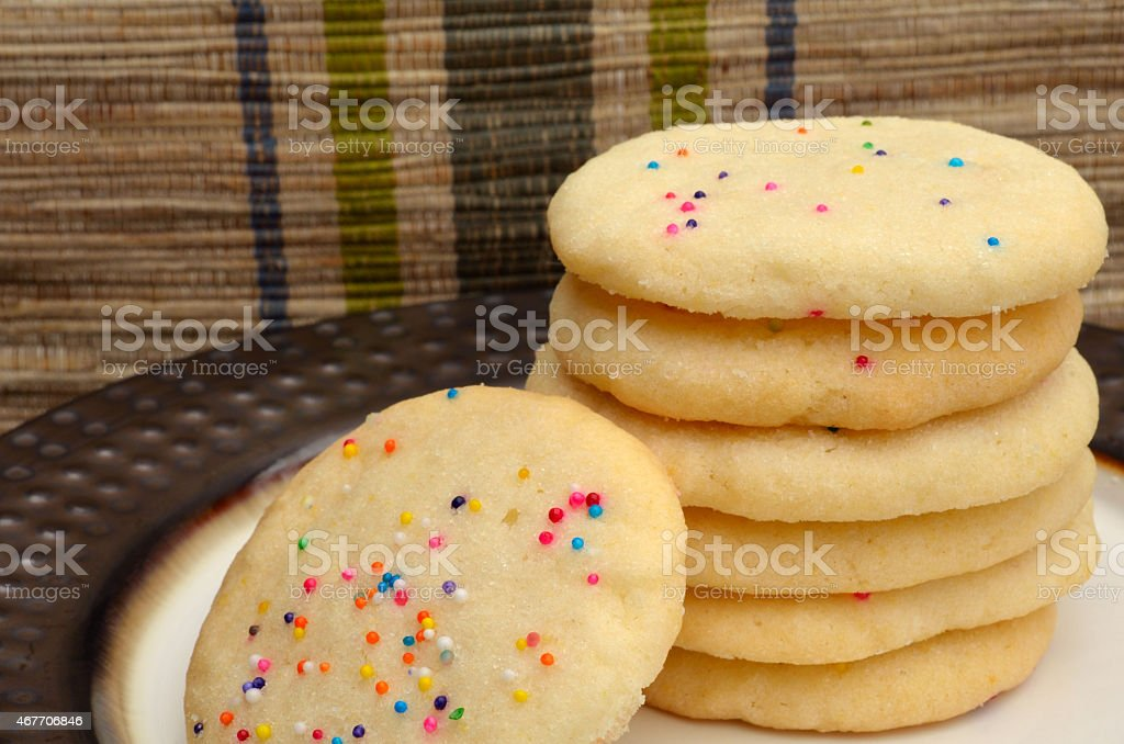 Stack of sweet sugar cookies with sprinkles stock photo