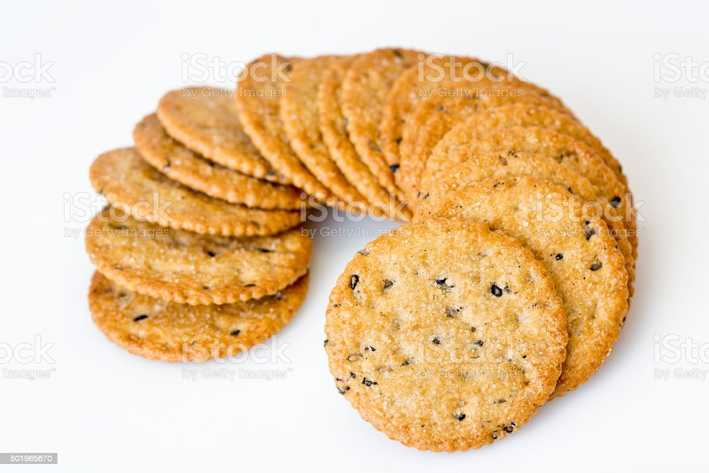 Stack of sweetmeat digestive biscuits isolated on white. stock photo