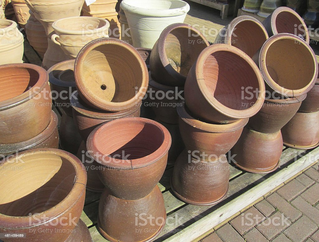 Stack of terracotta pots stock photo