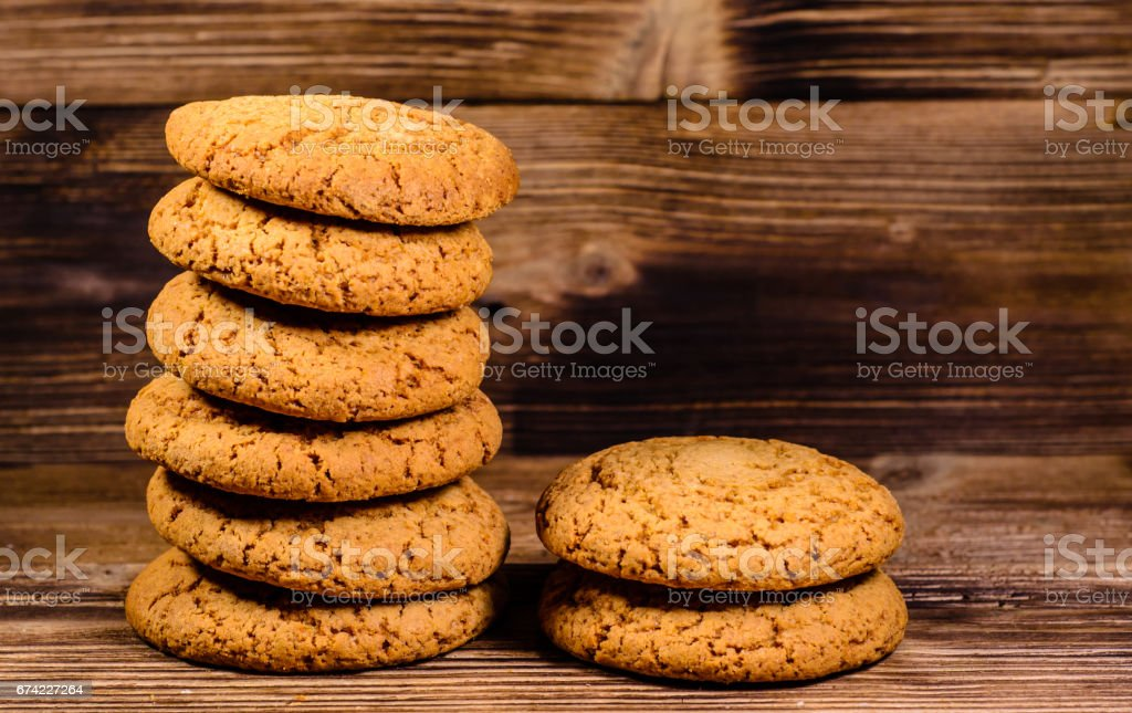 Stack of the oatmeal cookies on wooden table stock photo