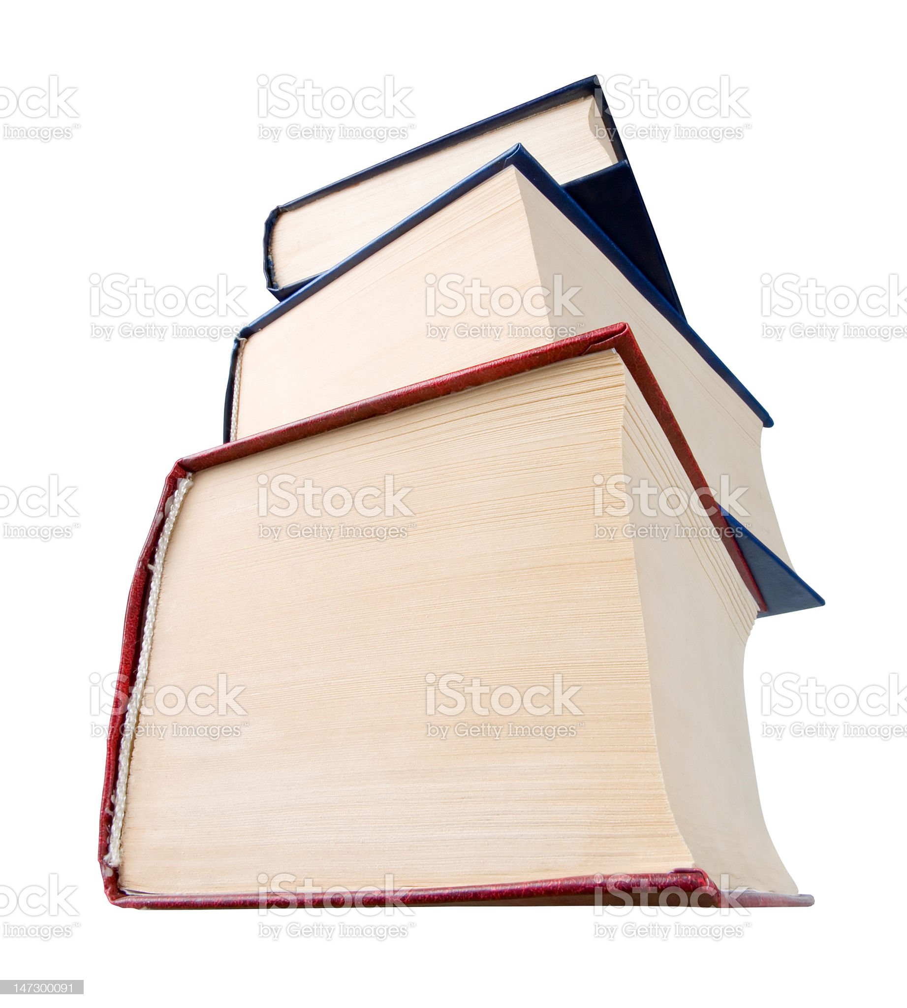 Stack of thick hardback books against white background royalty-free stock photo