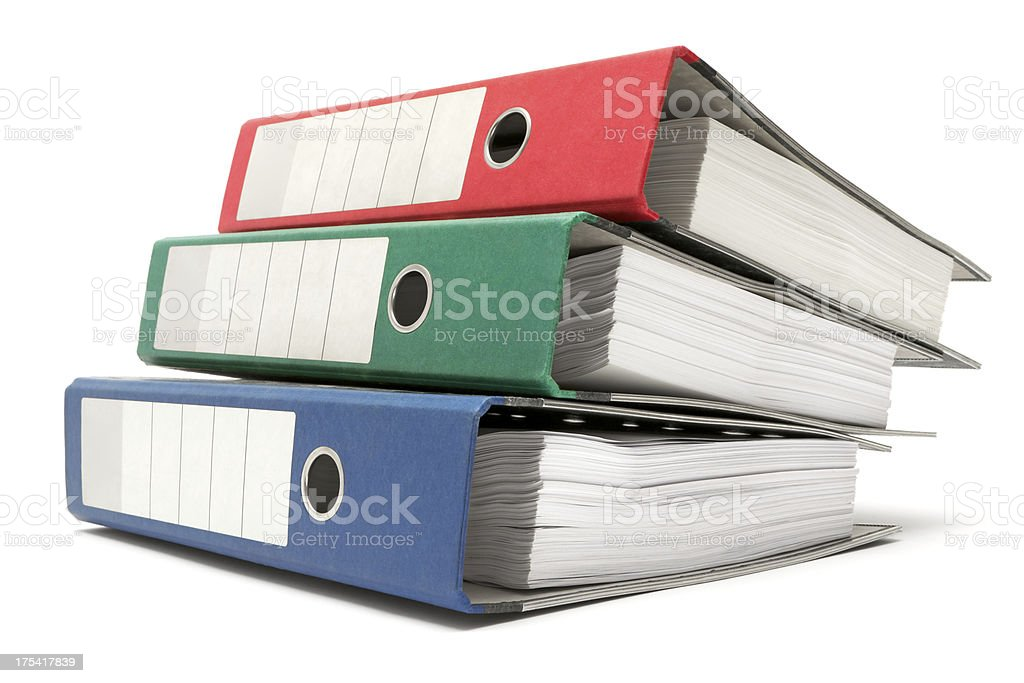 Stack of Three Colored Ring Binders stock photo