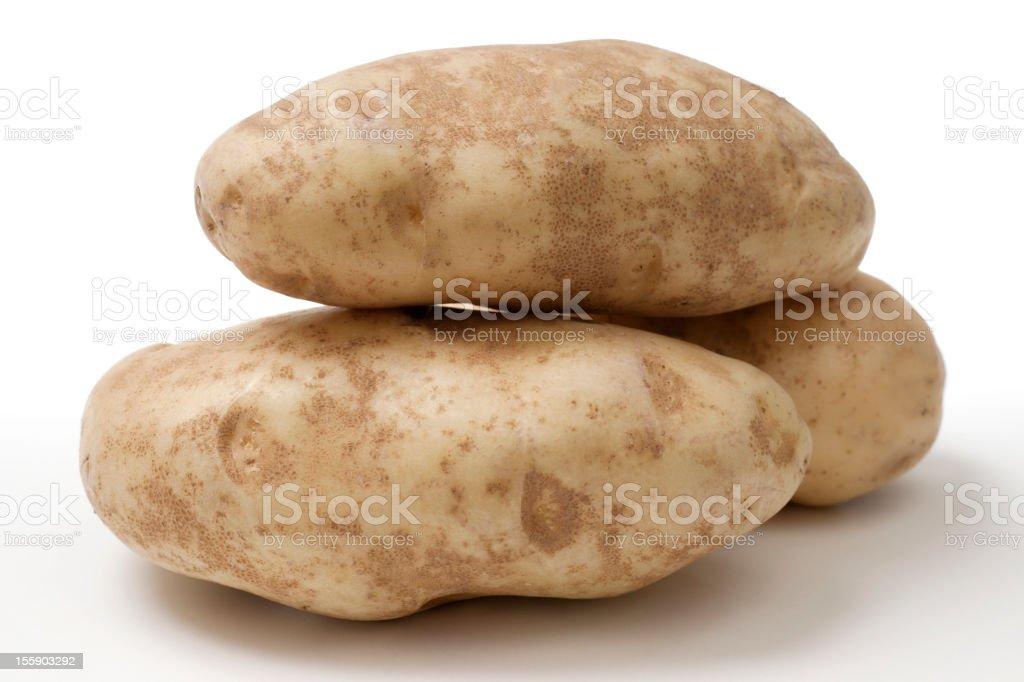 Stack of Three Idaho Russet Baking Potatoes on White Background stock photo