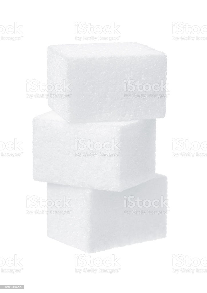Stack of three sugar cubes on white background stock photo