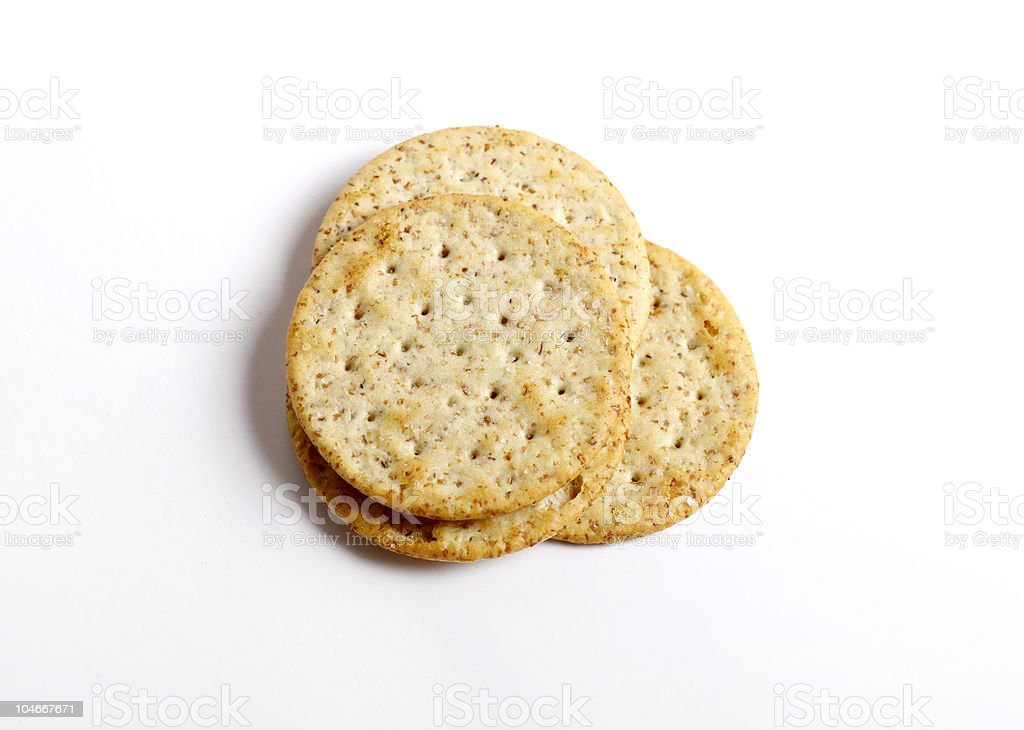 Stack of three whole wheat crackers stock photo