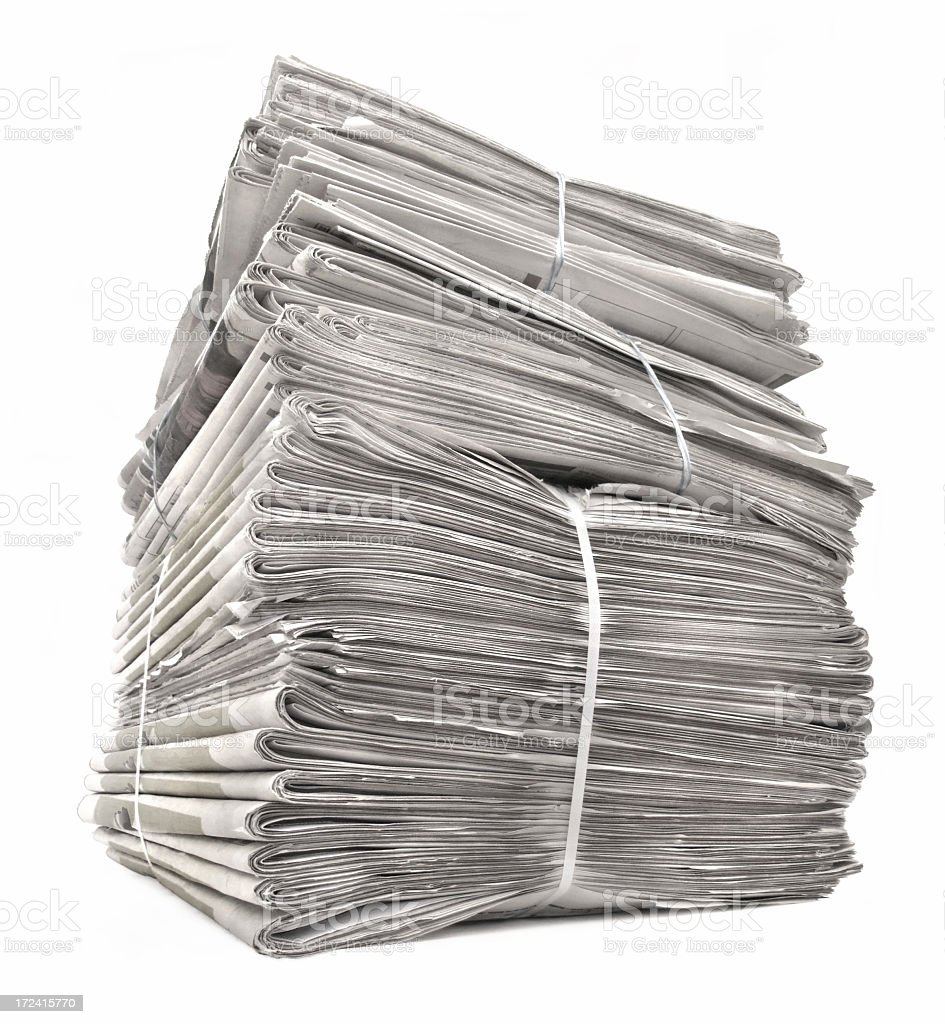 A stack of tied newspapers on white royalty-free stock photo