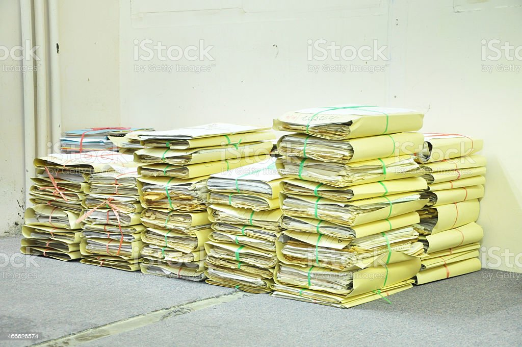 Stack Of Tied Old Files Yellowing On Office Floor stock photo