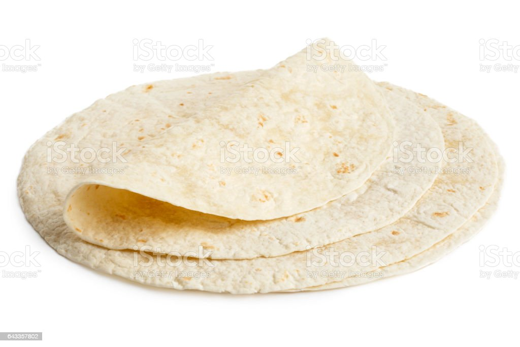 Stack of tortilla wraps and one folded wrap. stock photo