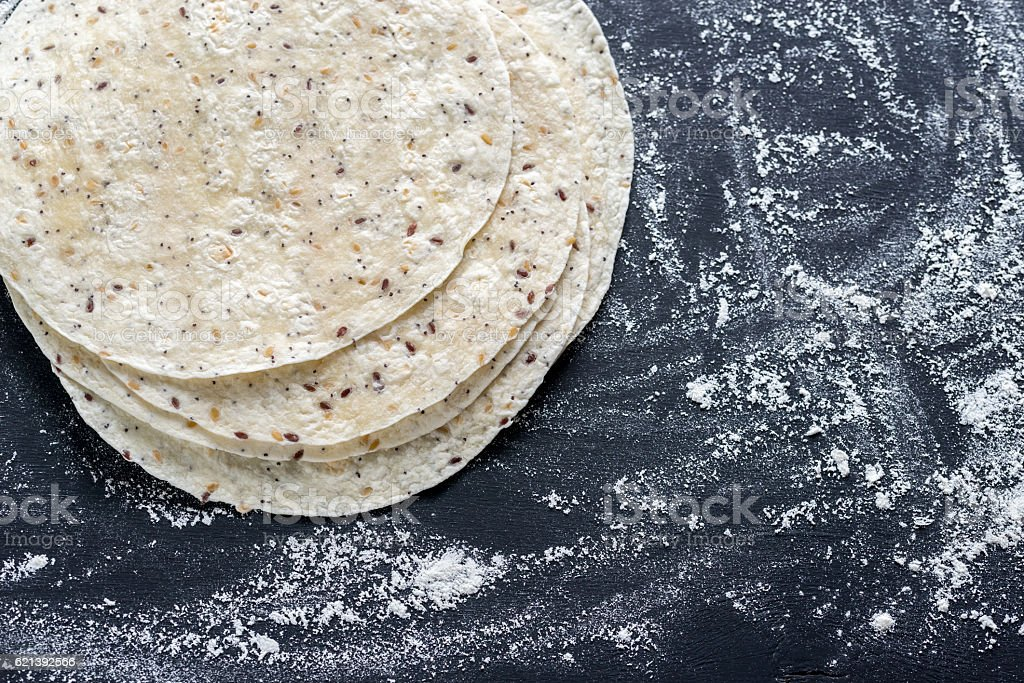 Stack of tortillas on a black surface stock photo