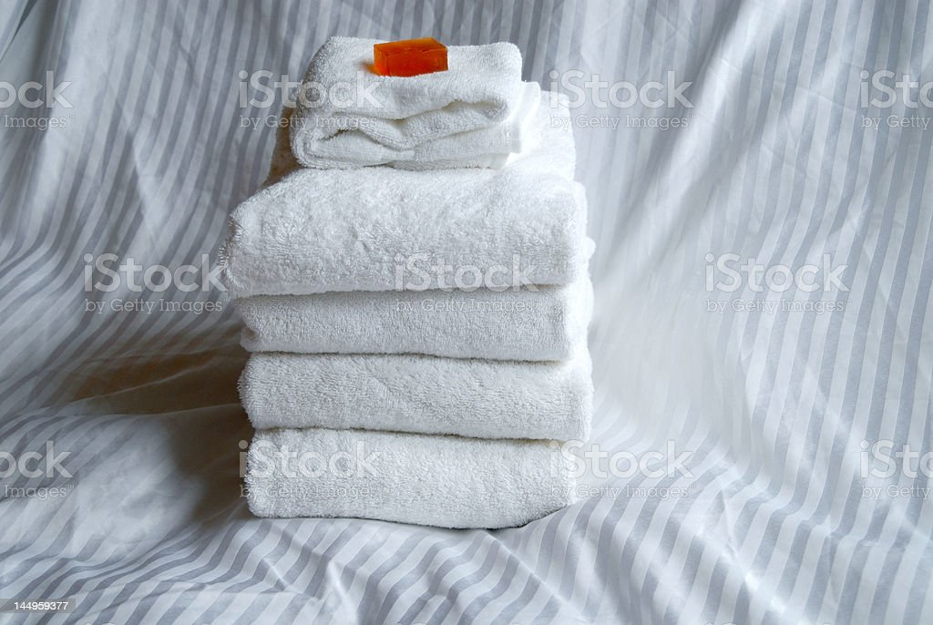 Stack of towels with soap horiz royalty-free stock photo