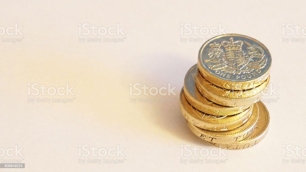 Stack of UK pound coins stock photo