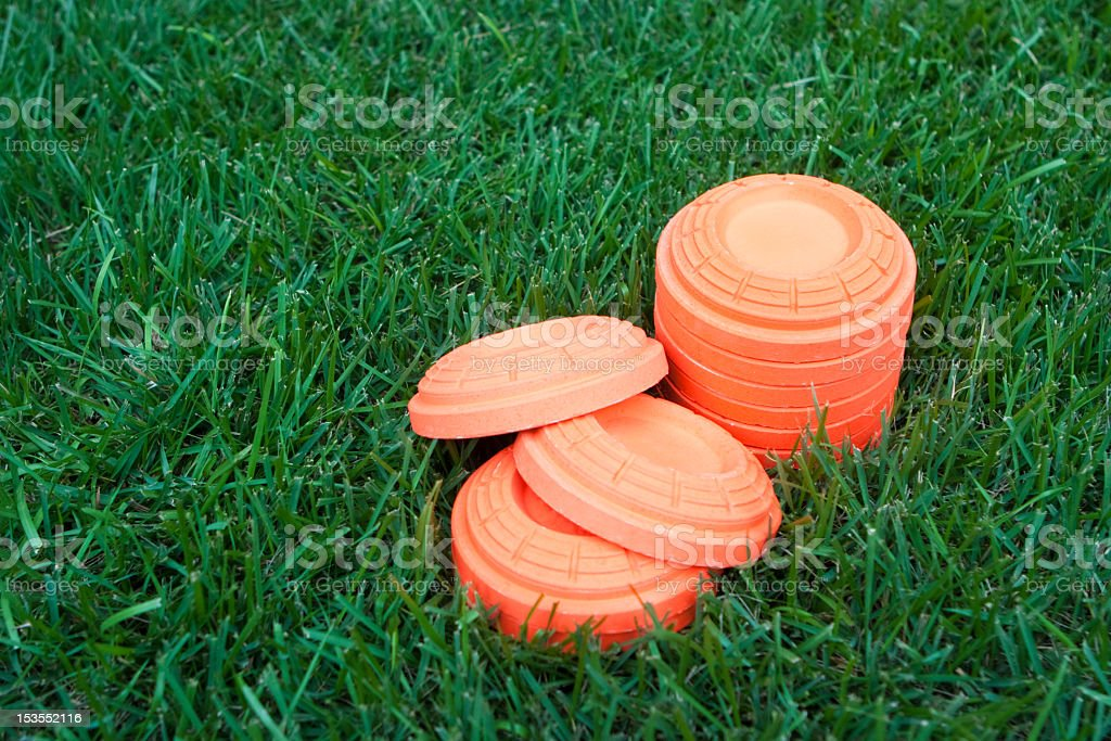 Stack of unbroken clay pieces laying on the grass stock photo
