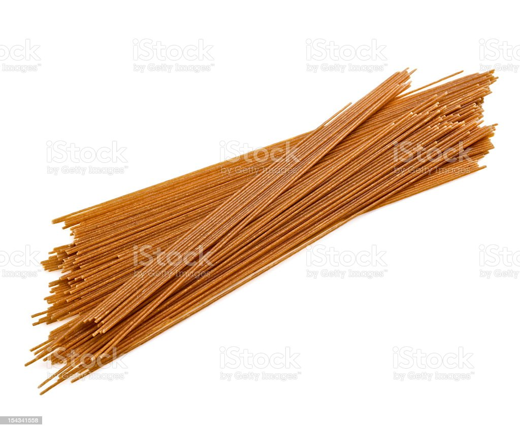 Stack of uncooked whole grain pasta stock photo