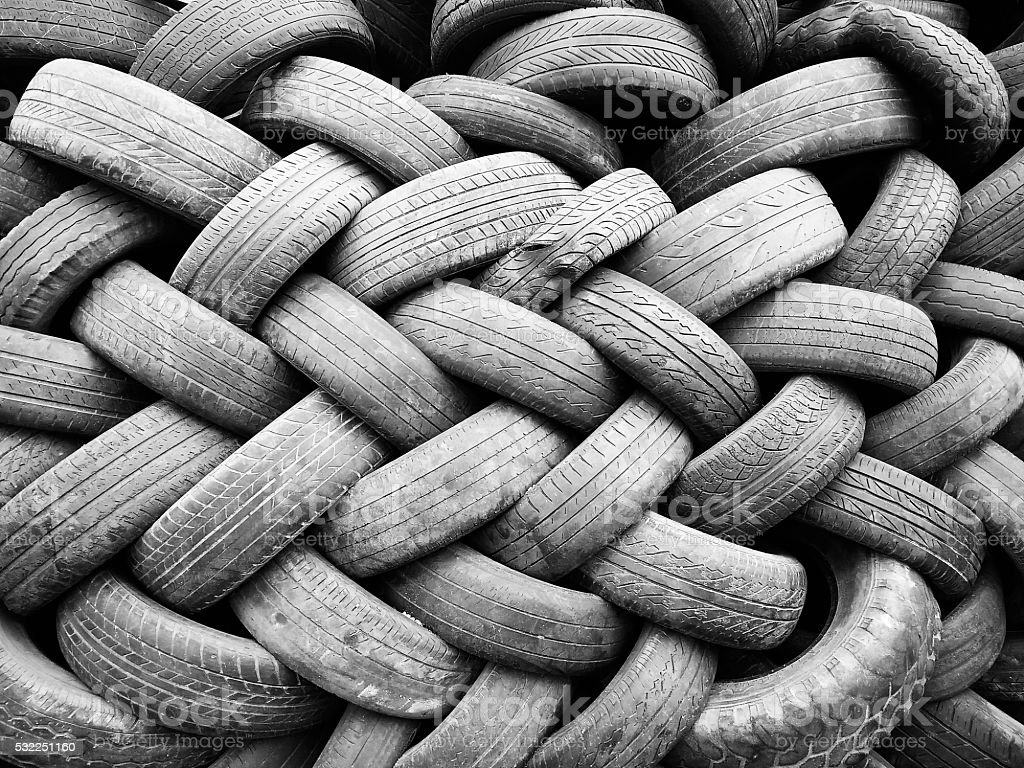Stack of used automotive tires stock photo