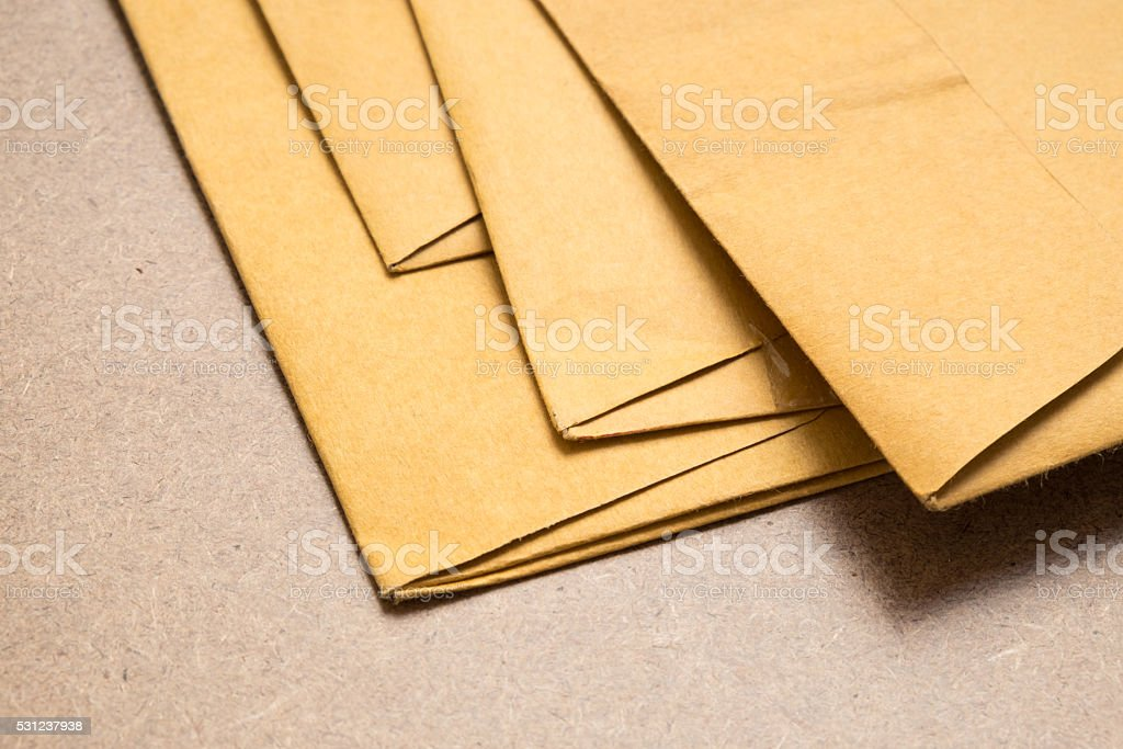Stack of used brown envelopes stock photo