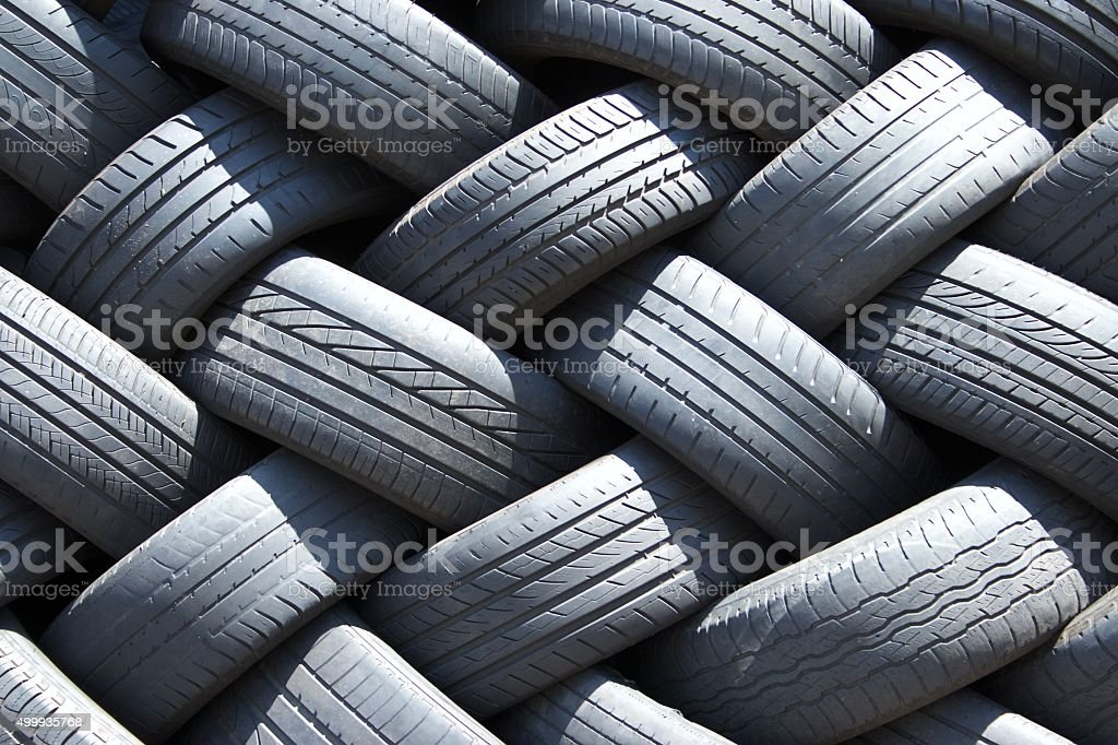 Stack of used car tires in the garage stock photo