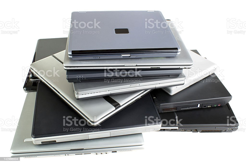 Stack of used laptops royalty-free stock photo