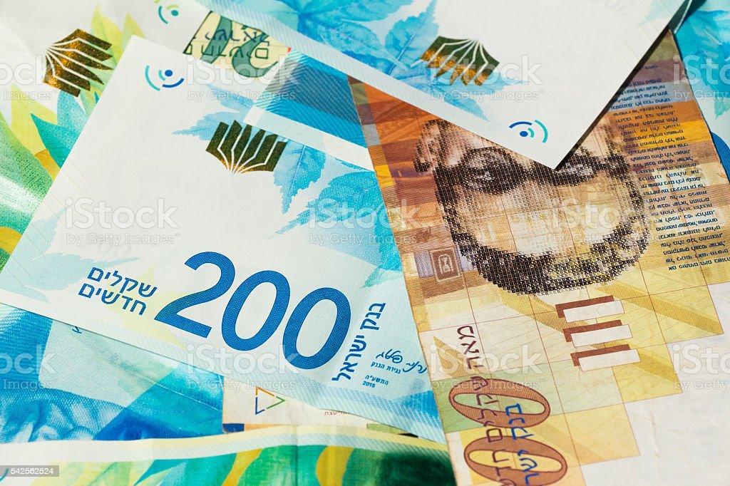 Stack of various of israeli shekel money bills stock photo