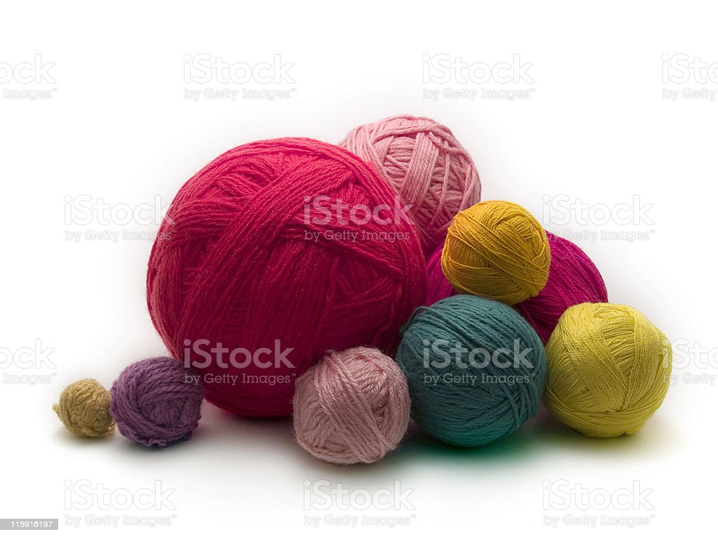 Stack of various sized yarn balls of bright colors royalty-free stock photo