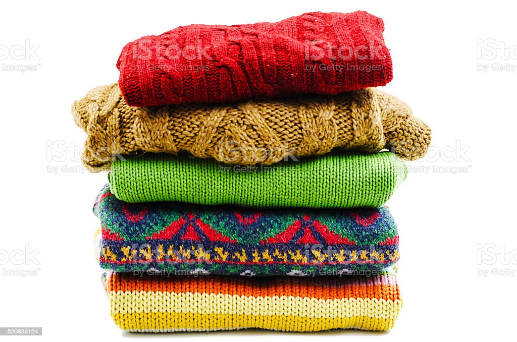 Stack of various sweaters. Winter style stock photo