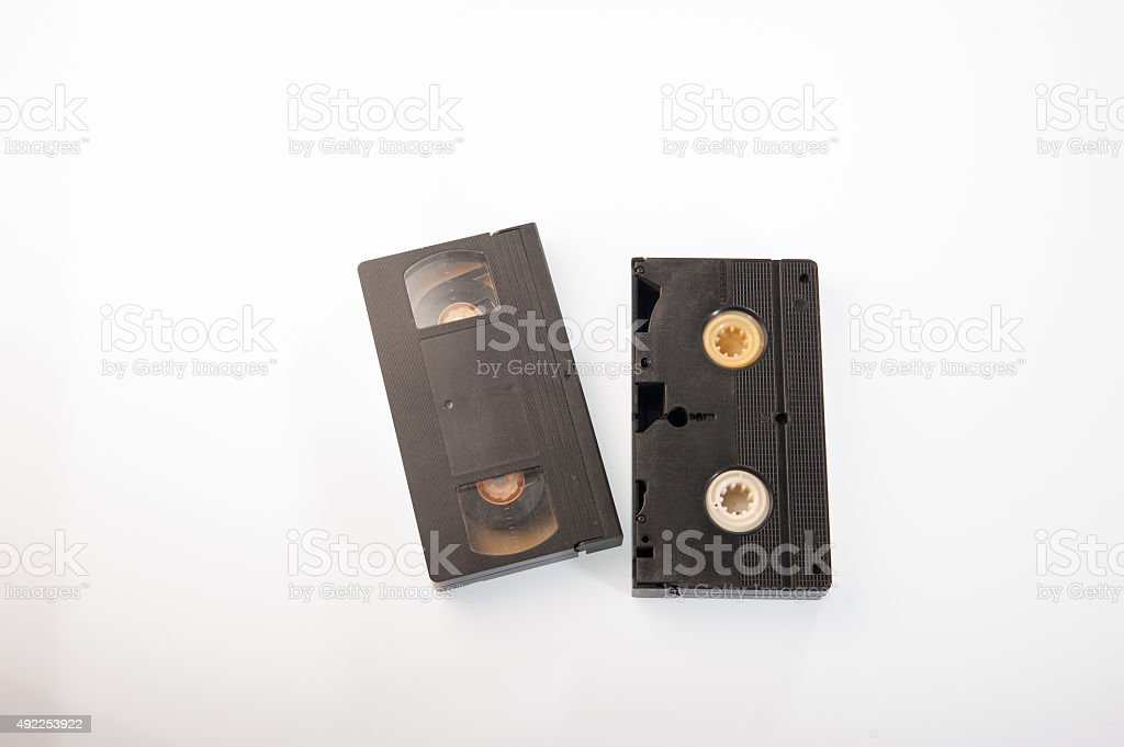 stack of VHS video tape cassette on white background. stock photo