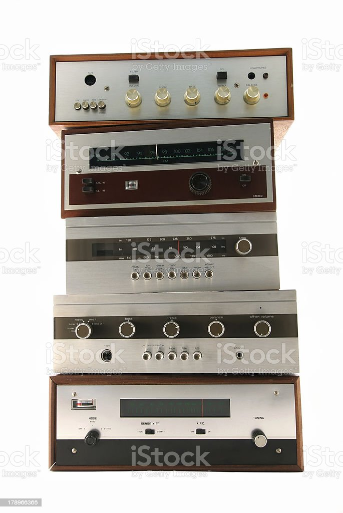 A stack of vintage radios against a white background stock photo