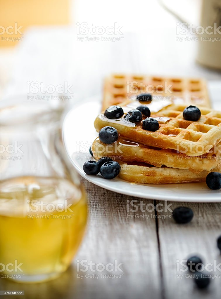 Stack of waffle  with blueberry and honey stock photo