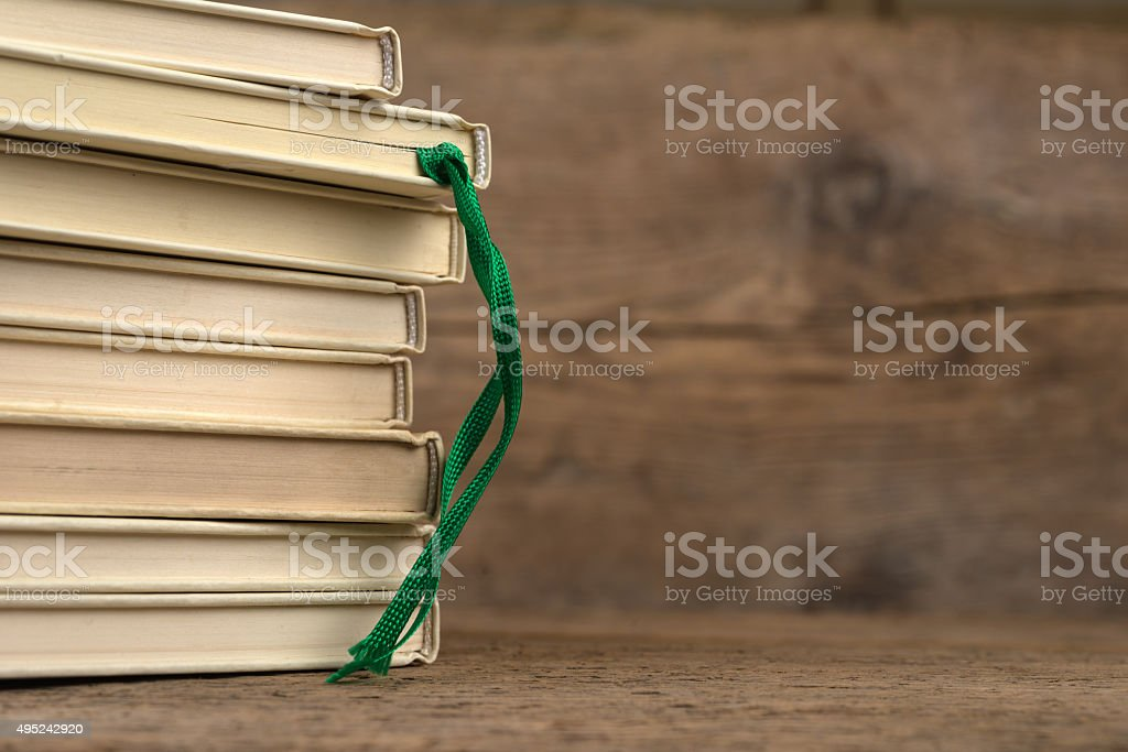 stack of white books with bookmark - satin ribbon stock photo