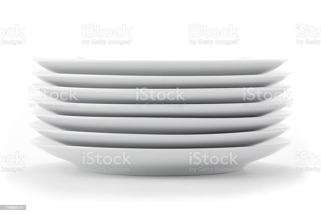 Stack of white plates stock photo