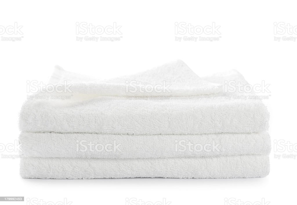 stack of white towels isolated stock photo