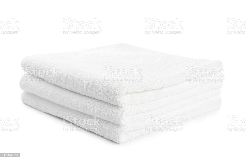 stack of white towels isolated royalty-free stock photo
