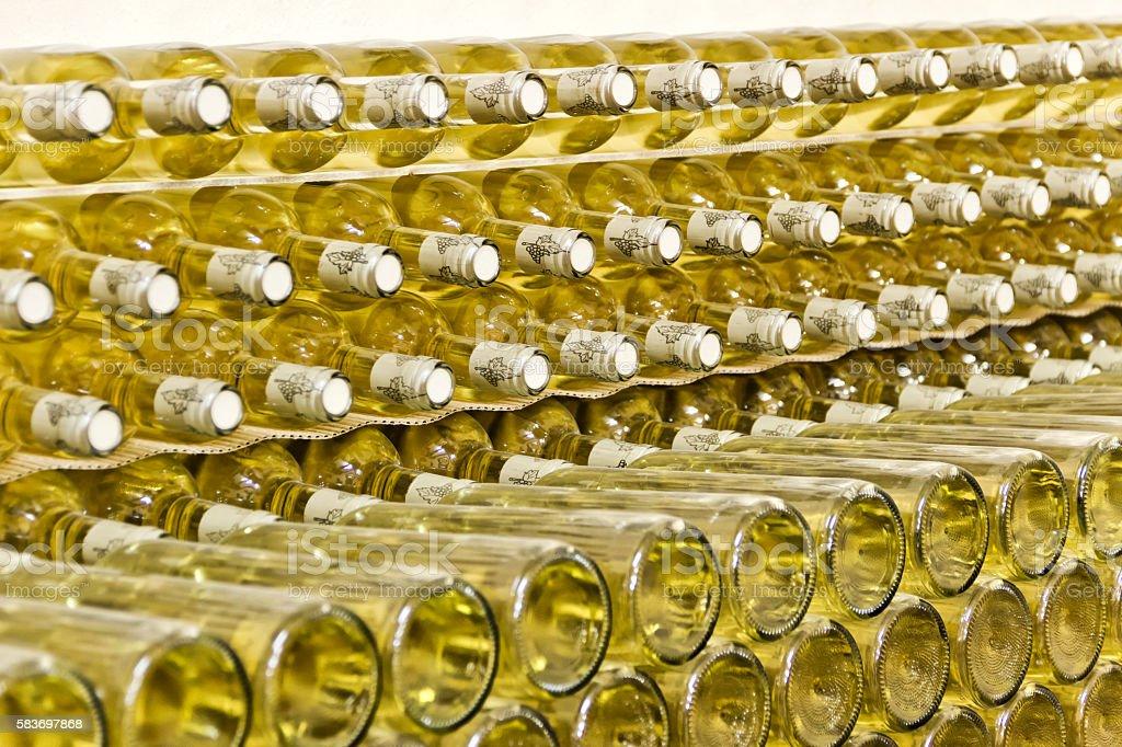 Stack of white wine bottles stock photo