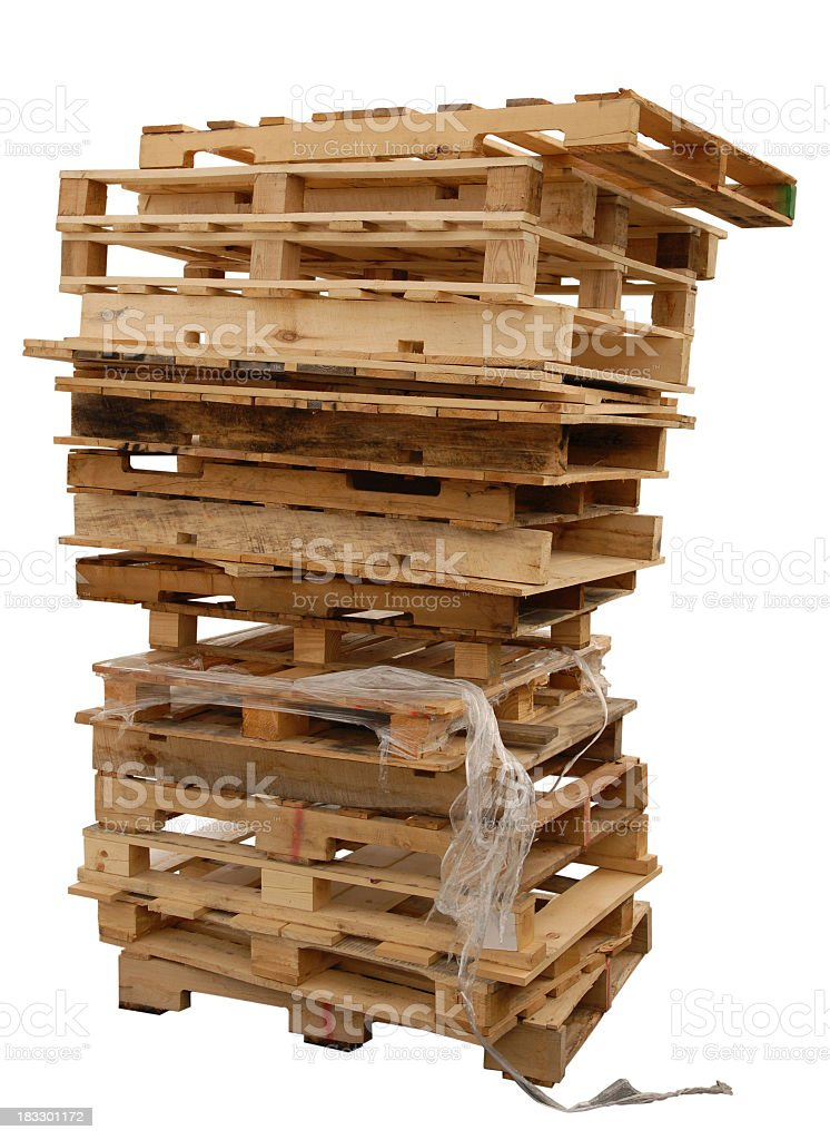 Stack of wooden pallets with plastic stock photo
