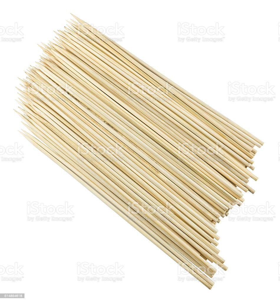 Stack of Wooden Skewers on A White Background stock photo