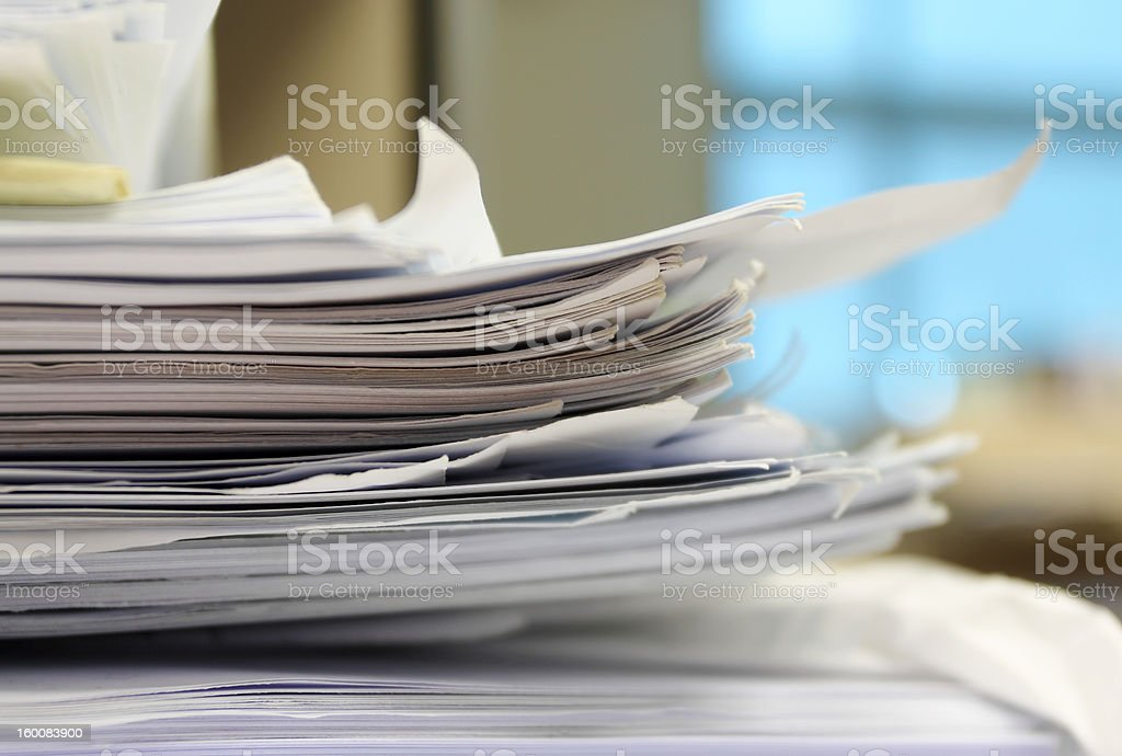 Stack of work papers stock photo