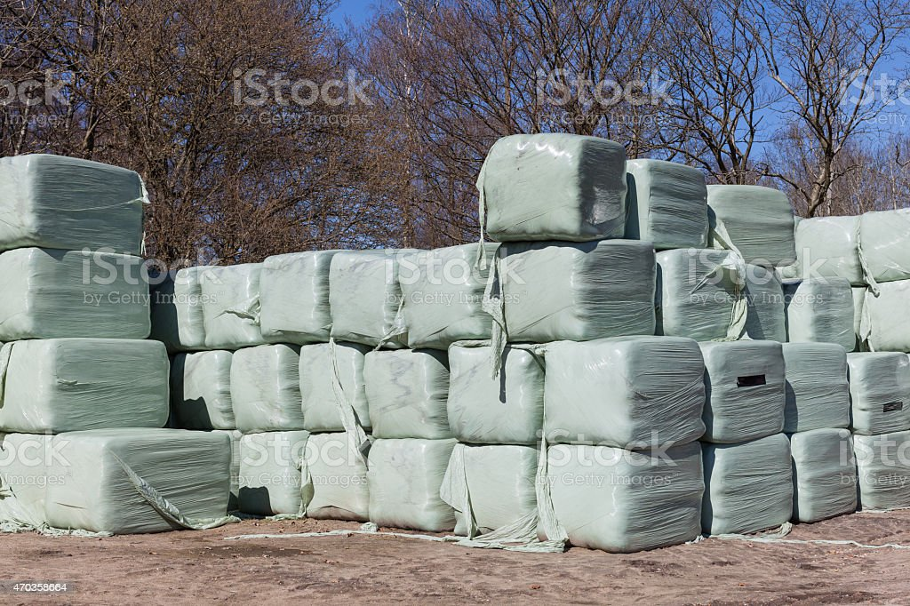 Stack of Wrapped Silage Bales stock photo