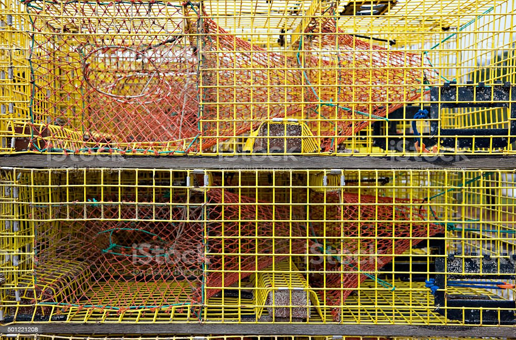 Stack of yellow lobster traps in Maine waterfront stock photo