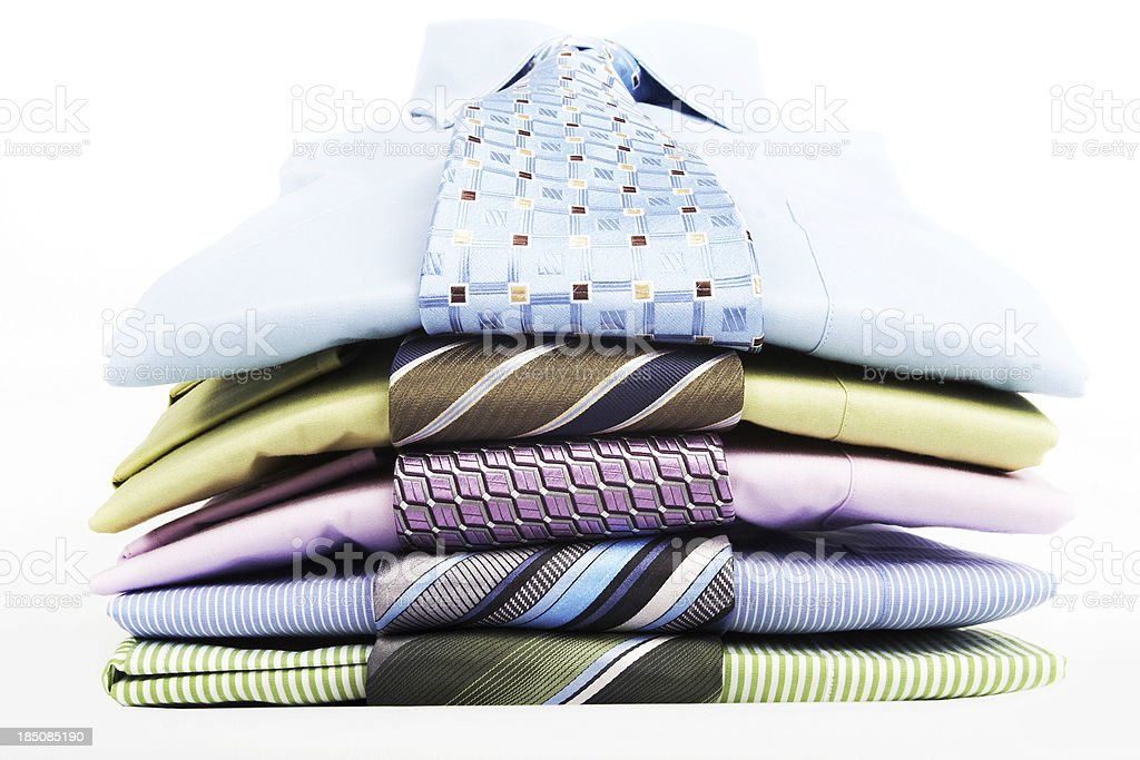 Stack pile of men's blue shirts and ties folded royalty-free stock photo