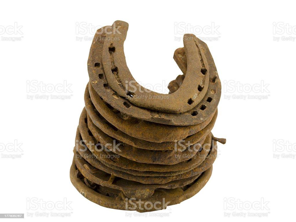 stack rusty retro horseshoes isolated on white royalty-free stock photo