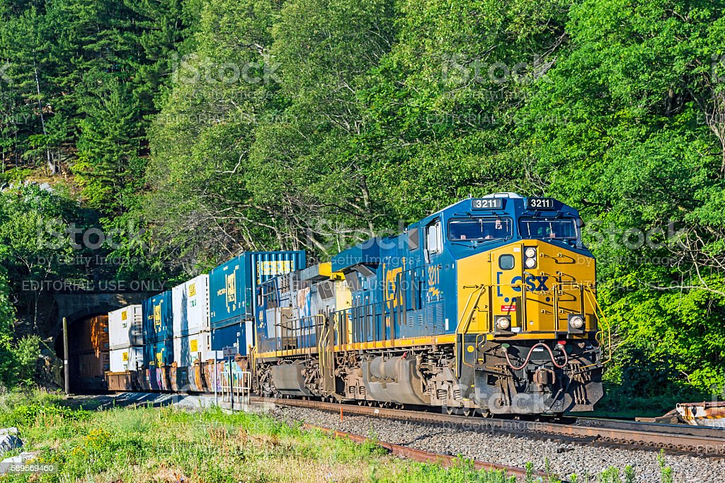 CSX stack train exits tunnel on East Coast River Line stock photo