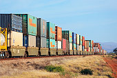 Stack train with multi-coloured containers on outback tracks