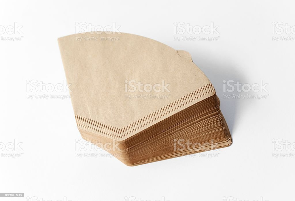 Stack unbleached brown coffee filter on white royalty-free stock photo