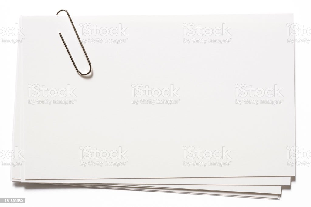 Stacked blank white cards with paper clip on white background stock photo
