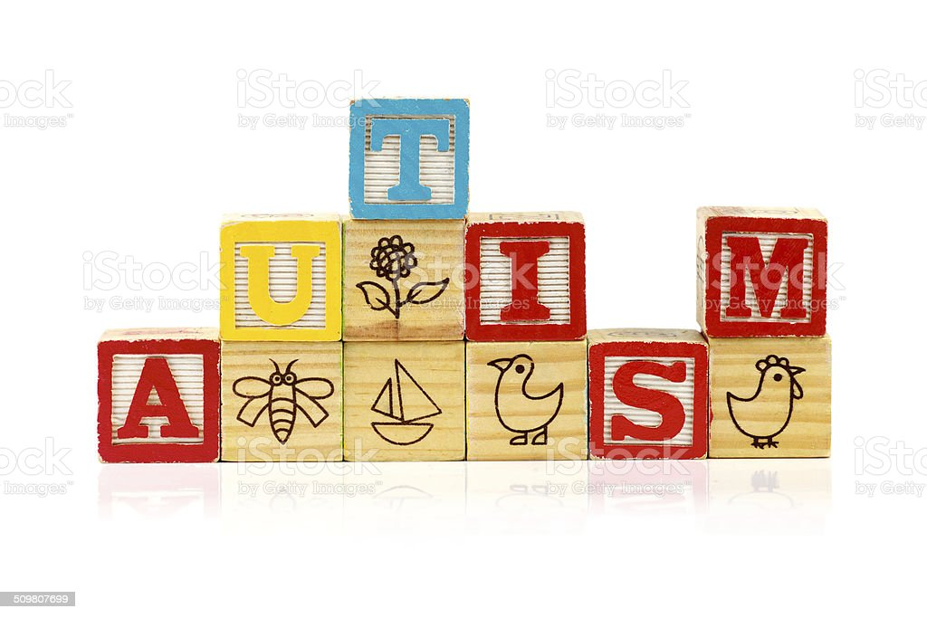 Stacked blocks spelling autism on white background stock photo
