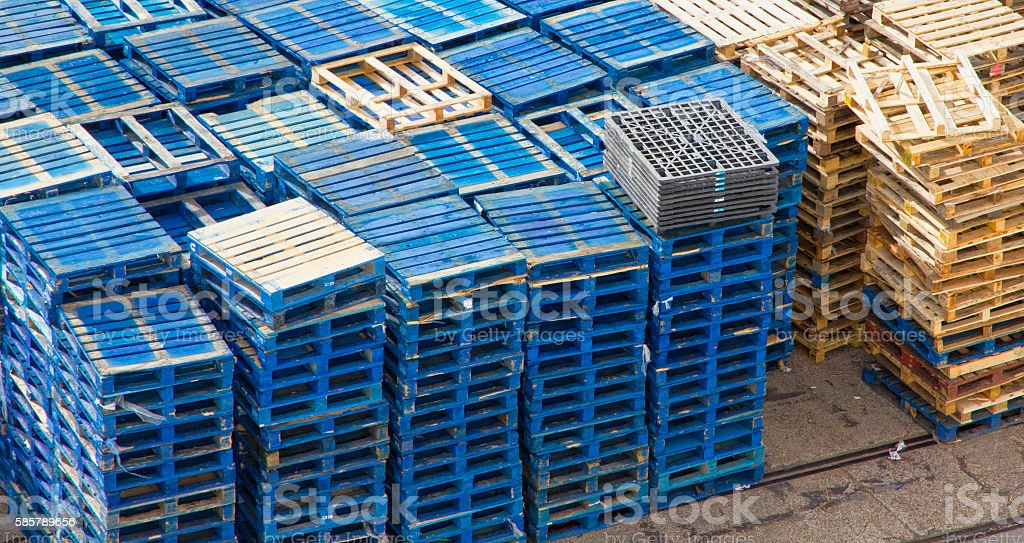 Stacked Blue Shipping Pallets stock photo