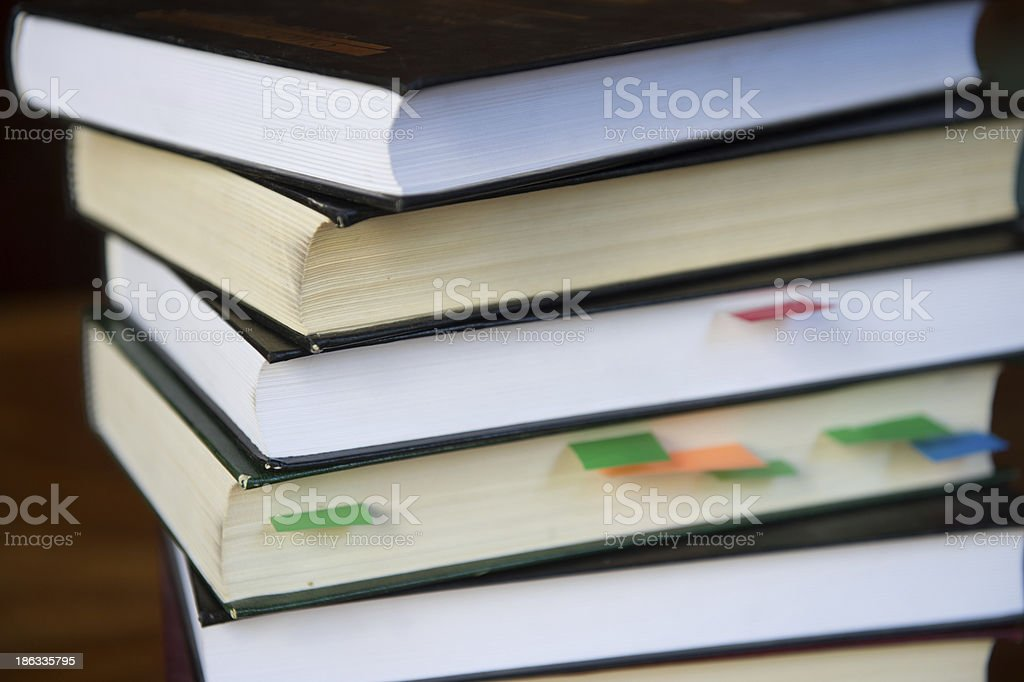 Stacked Books with colored paper sign royalty-free stock photo